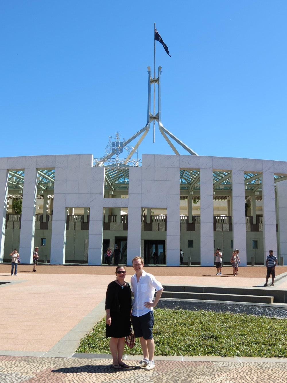 Fay and Sam post in front of the new Parliament Building in Canberra