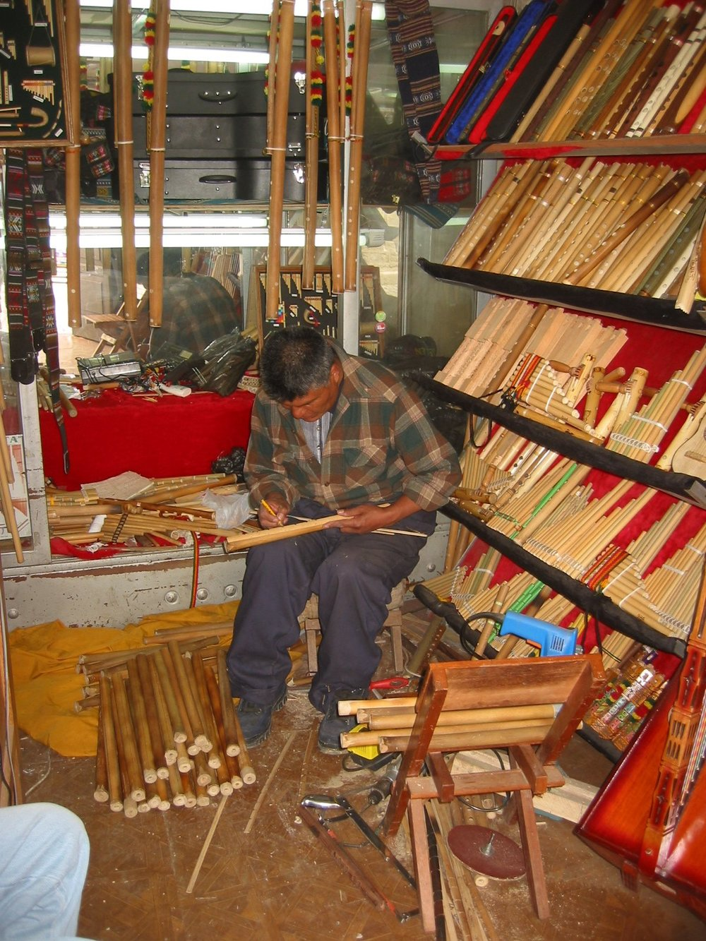 A flute maker plies his trade