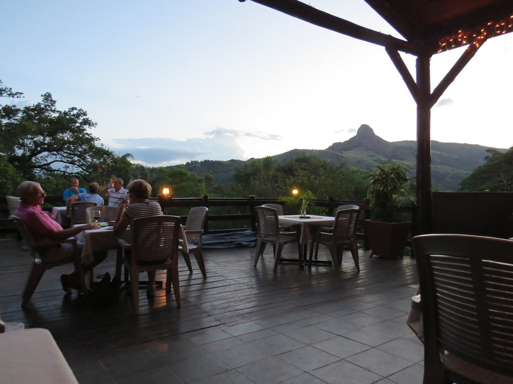 Casual dining at the Mantenga Lodge with a view of Execution Rock in the distance
