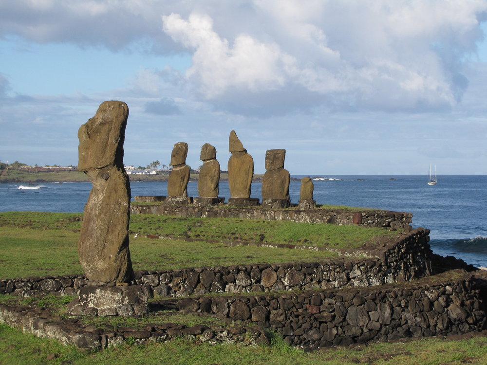 Moai on the shore at Hanga Roa with Nine of Cups anchored in the background.