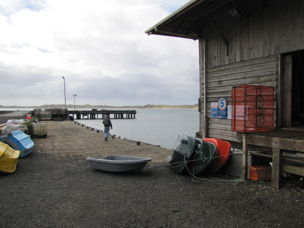 Checking the dinghy at the Waitangi wharf