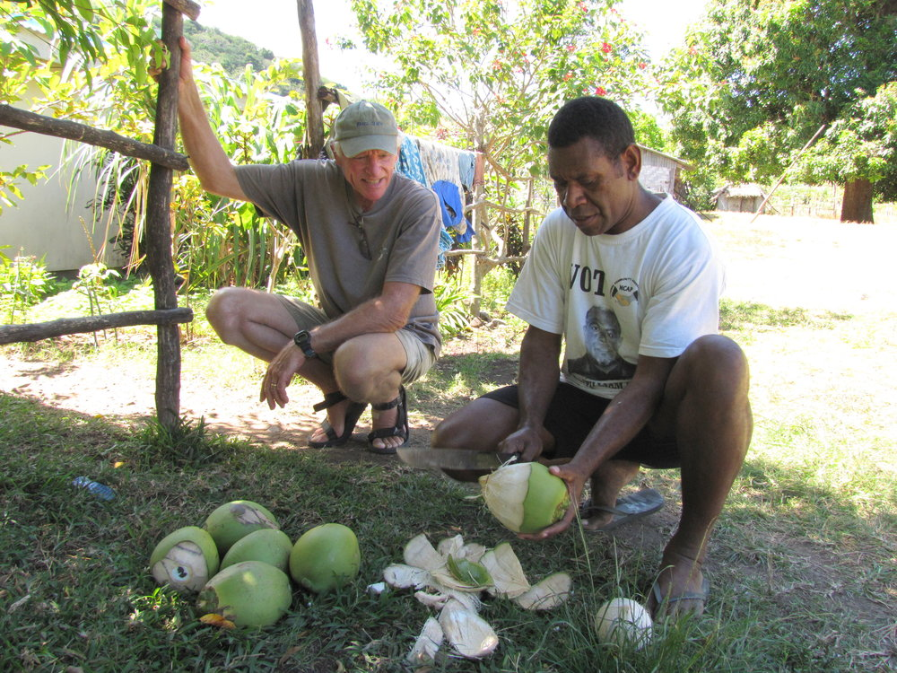 The local minister, Robbie, gave us a tour of the village as well as showing David the correct way to open green coconuts.