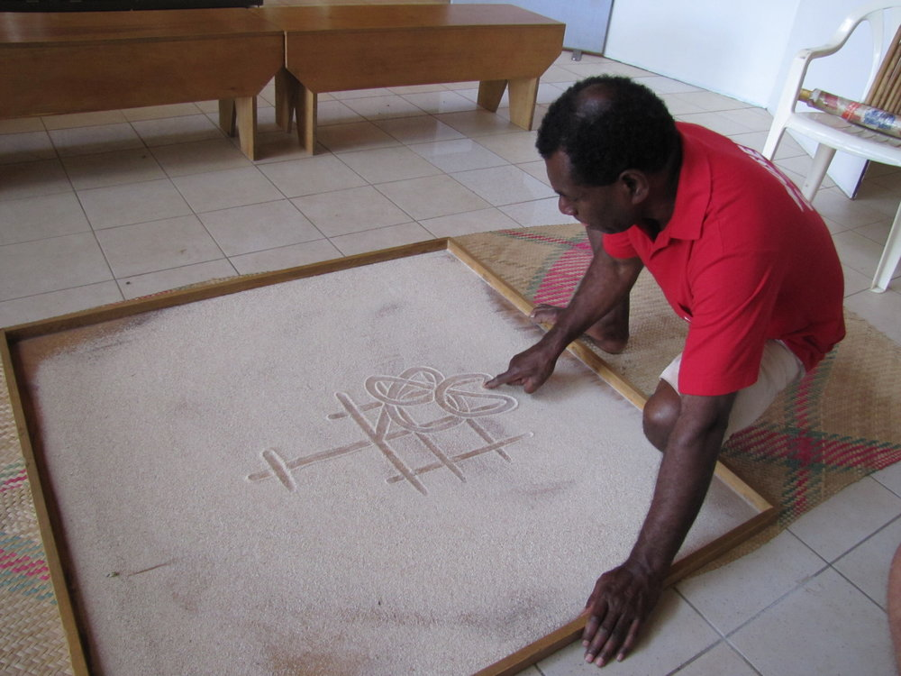 Sandroing (sand drawing) tells legends thru art.