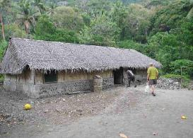 David heads into Sailon's house at Malekula to make solar panel repairs.