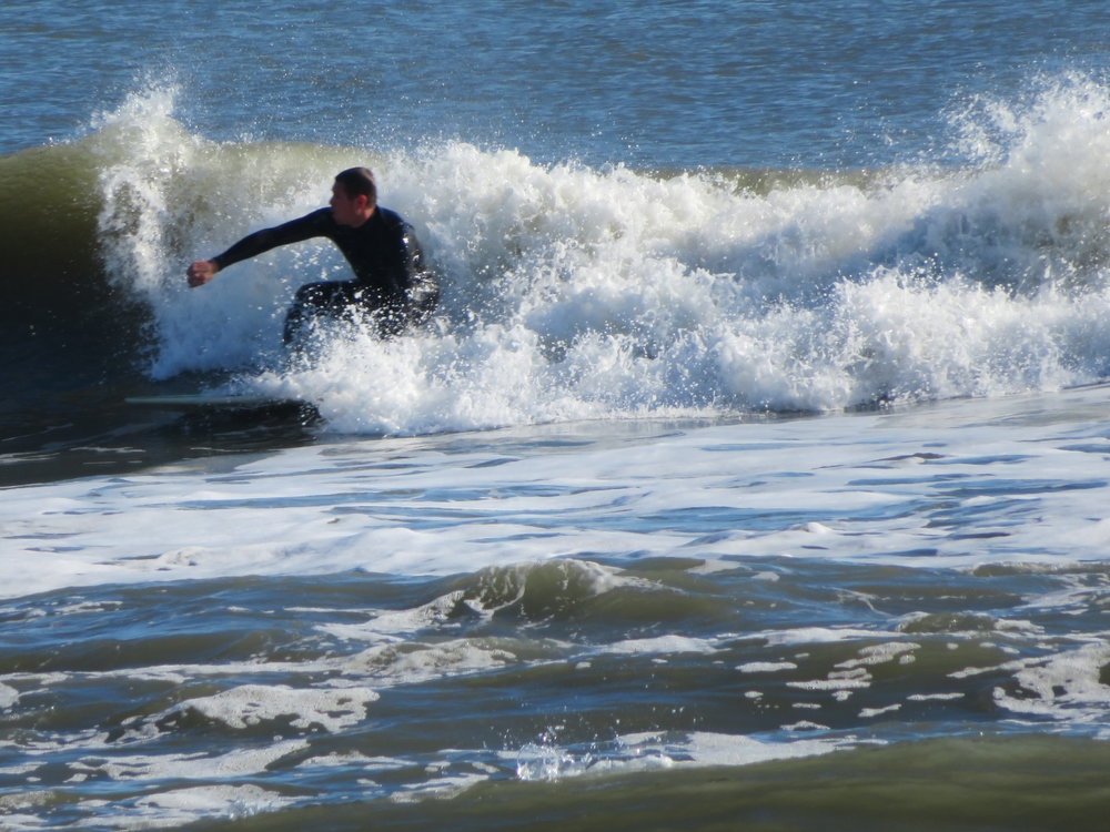A surfer catches the last of the season's waves.