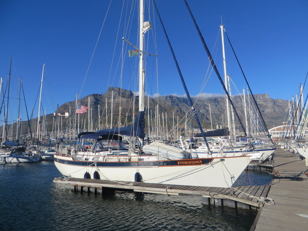 Cups safely tied up at the Royal Cape Yacht Club with Table Mountain as the backdrop ...  a circumnavigation of the world completed! Hooray!