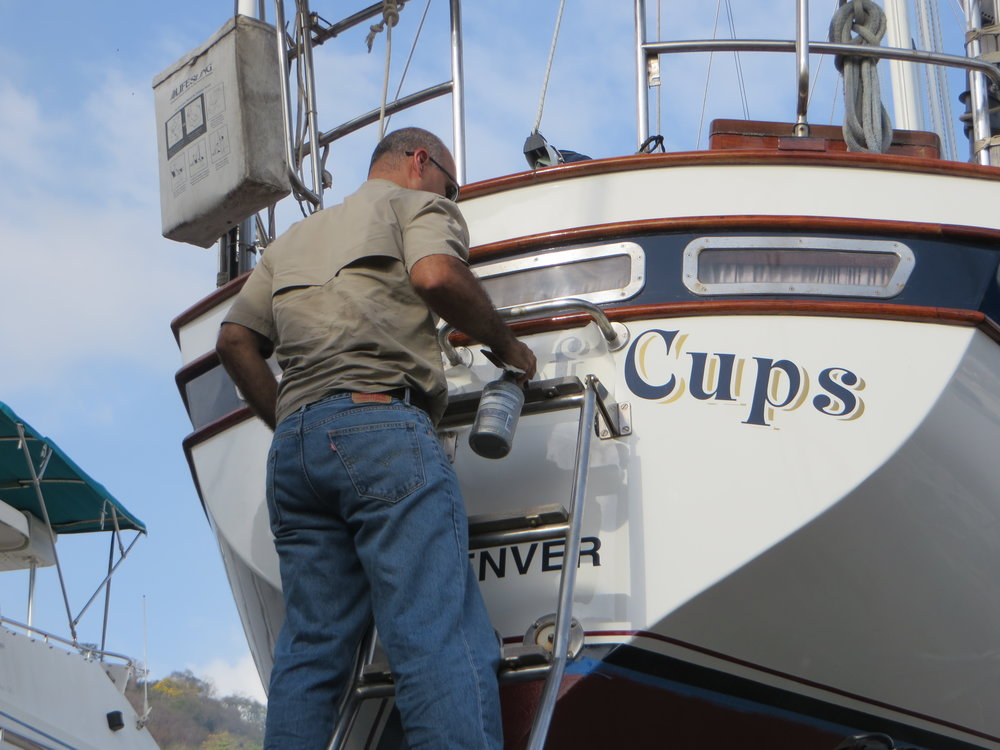Nine of Cups was all spruced up in Trinidad with new hull paint, sheerstripe, bootstripe, bottom job and even a new name decal.