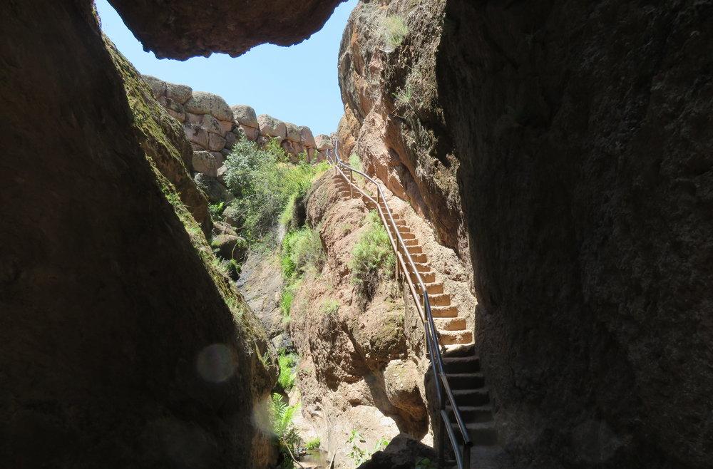 up narrow, worn stairs.