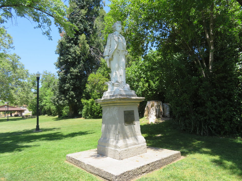 Mark Twain statue stands proudly in Utica Park.
