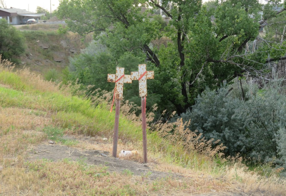 Montana places a white metal cross marker along the highway at sites of auto fatalities and there have been scores of them along our route.