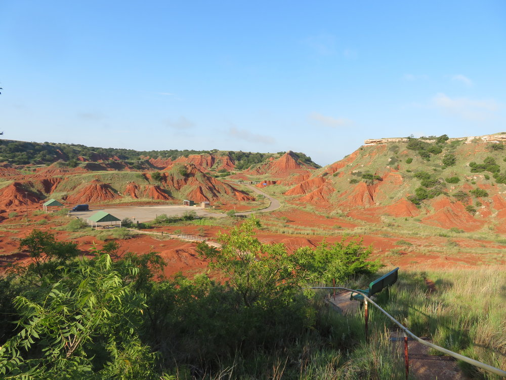 A view of the iron-rich red Oklahoma terrain from the top of the mesa at Gloss Mountain. Can you see Blue parked far below?