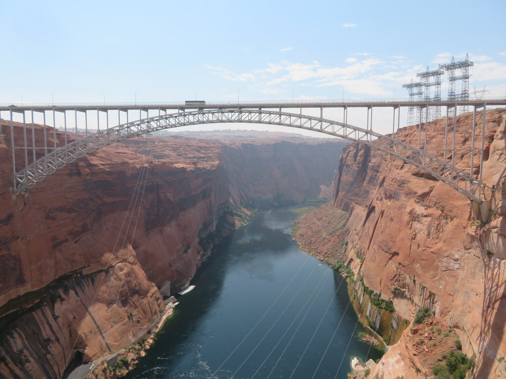 The Glen Canyon steel arch bridge rises 700' above the Colorado River.