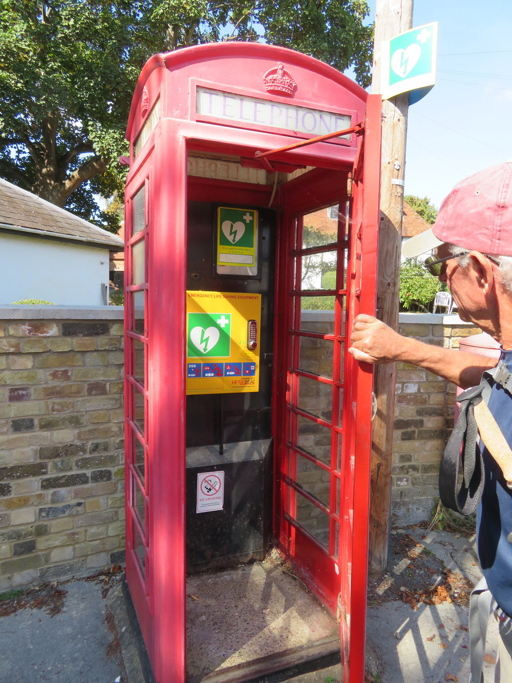 We found another red English phone booth today … it had a defibrillator inside along with instructions for use! Yikes!