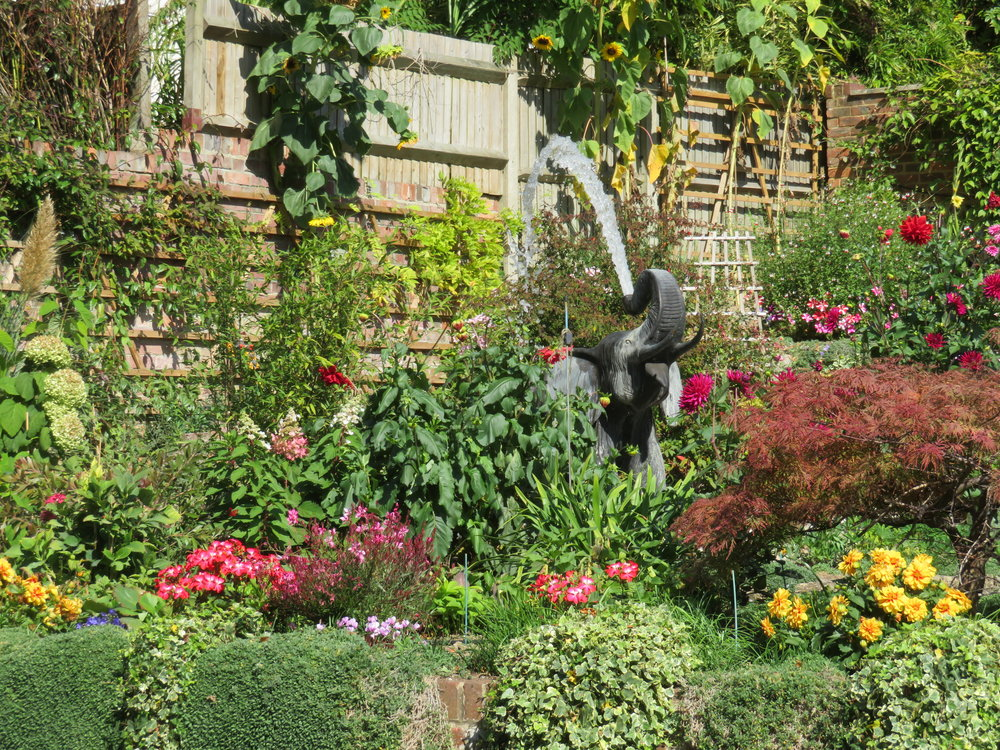 As we walked from the path up the final hill to our hotel in Goring, we spotted a fine English garden all a-bloom with an interesting elephant fountain spouting water from his trunk.