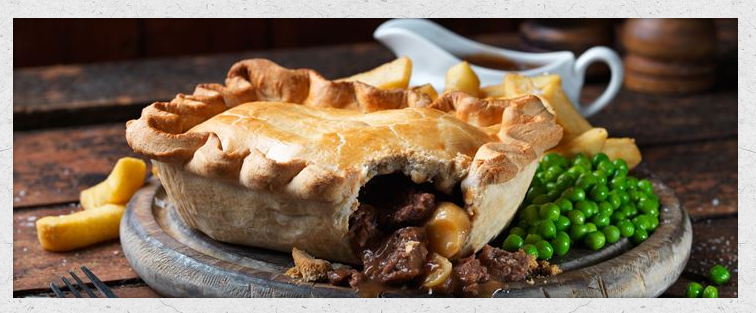 A beef and kidney pie - with those ubiquitous peas