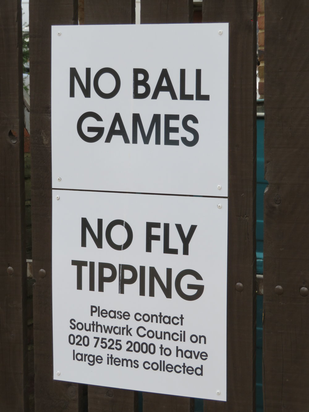 It was easy to figure out 'no ball games' in this parking lot, but 'no fly tipping' had us scratching our heads. We later learned 'fly tipping' is illegal dumping of trash.