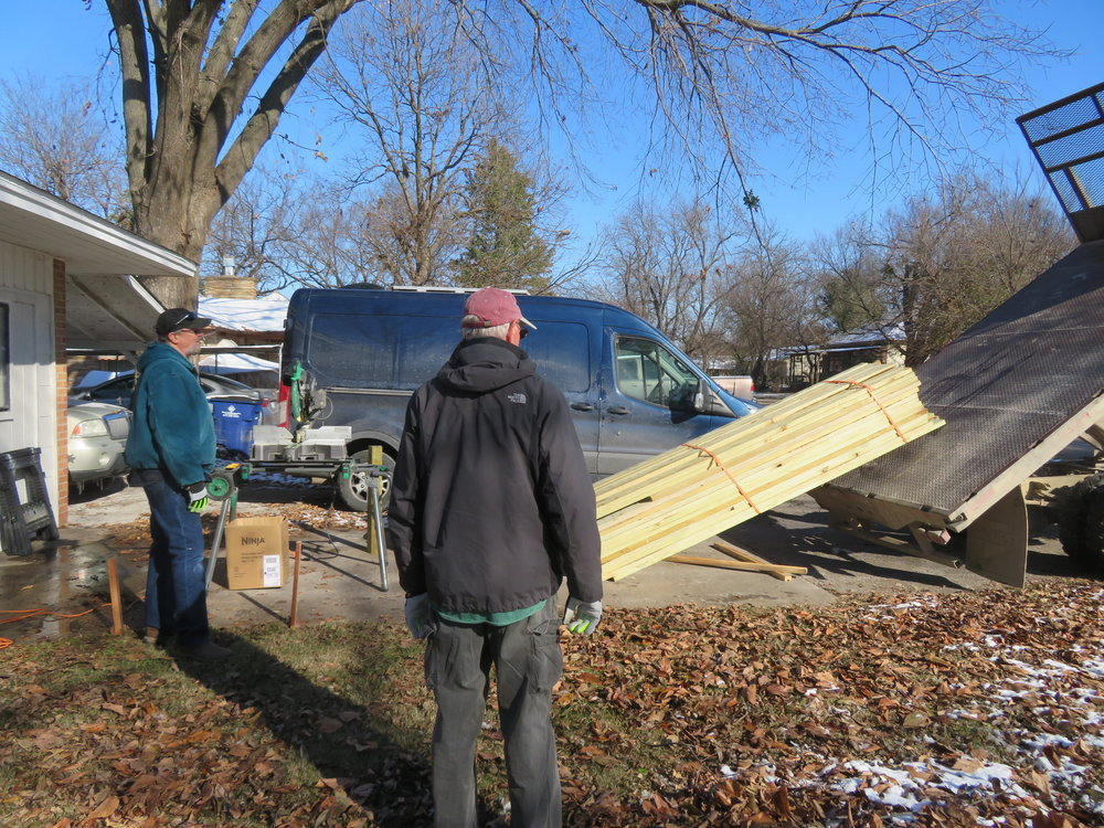 Pressure-treated lumber was ordered in advance and delivered by the local lumberyard.