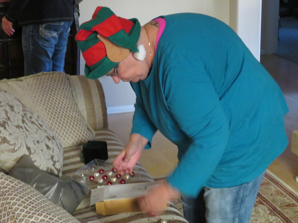 Mary donned her elf hat which made decorating much easier.