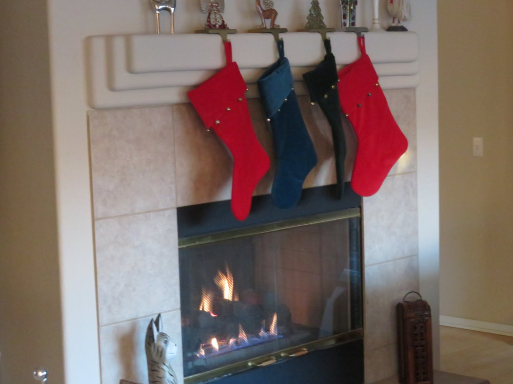 The stockings were hung by the gas fireplace with care.