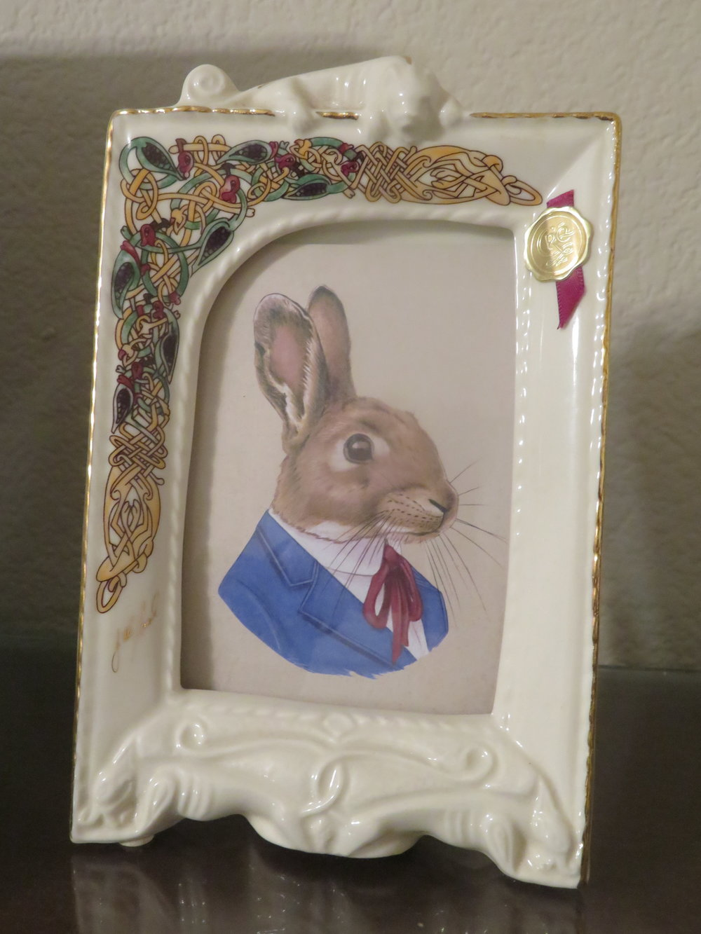 Uncle Rabbit happily dwells in the CRE picture frame until I can find another photo to take his place.