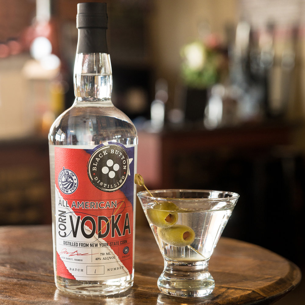 Black Button Distilling All American Corn Vodka next to a vodka cocktail