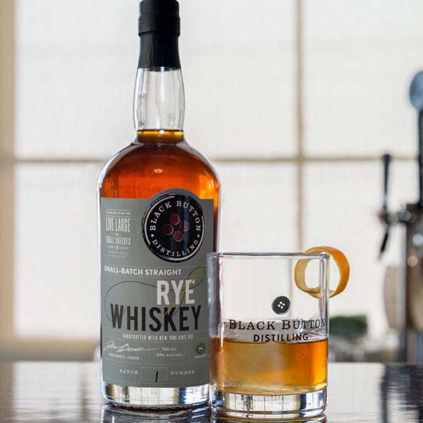 Black Button Distilling Small Batch Straight Rye Whiskey next to Straight Rye Whiskey cocktail