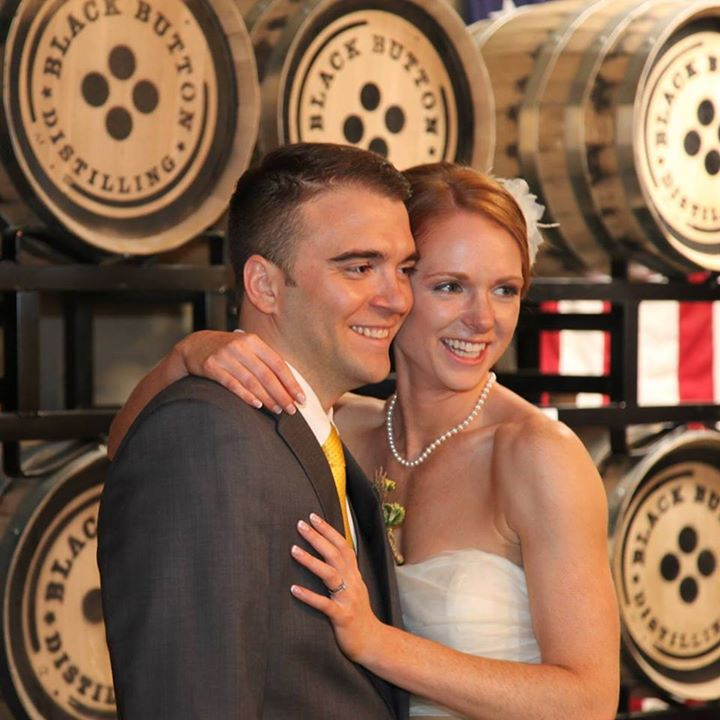 BrideandGroomwithBarrels.jpg