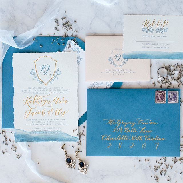 @oceanandcoralcalligraphy - Kathy does the most beautiful invitation sets! We can't get over this Parisian blue set!! Planner: @MagnificentMomentsWeddings | Photographer: @charlotteweddingcollective | Cake: @stlcakes | Calligraphy: @oceanandcoralcalligraphy | Venue: @southerncharmevents | Rentals: @evermoreeventco | Model (Bride): Dana @danarenata | Model (Groom): Jacob @jacobearly14 | Flowers: @MagnificentMomentsWeddings | Hair: Michelle Seuss @ | Make-up: Jennifer Carver @ | Dress: @jmajorsbridal