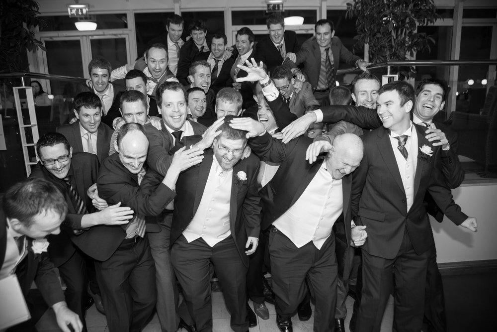 Tom O'Neill groomsmen celebrate