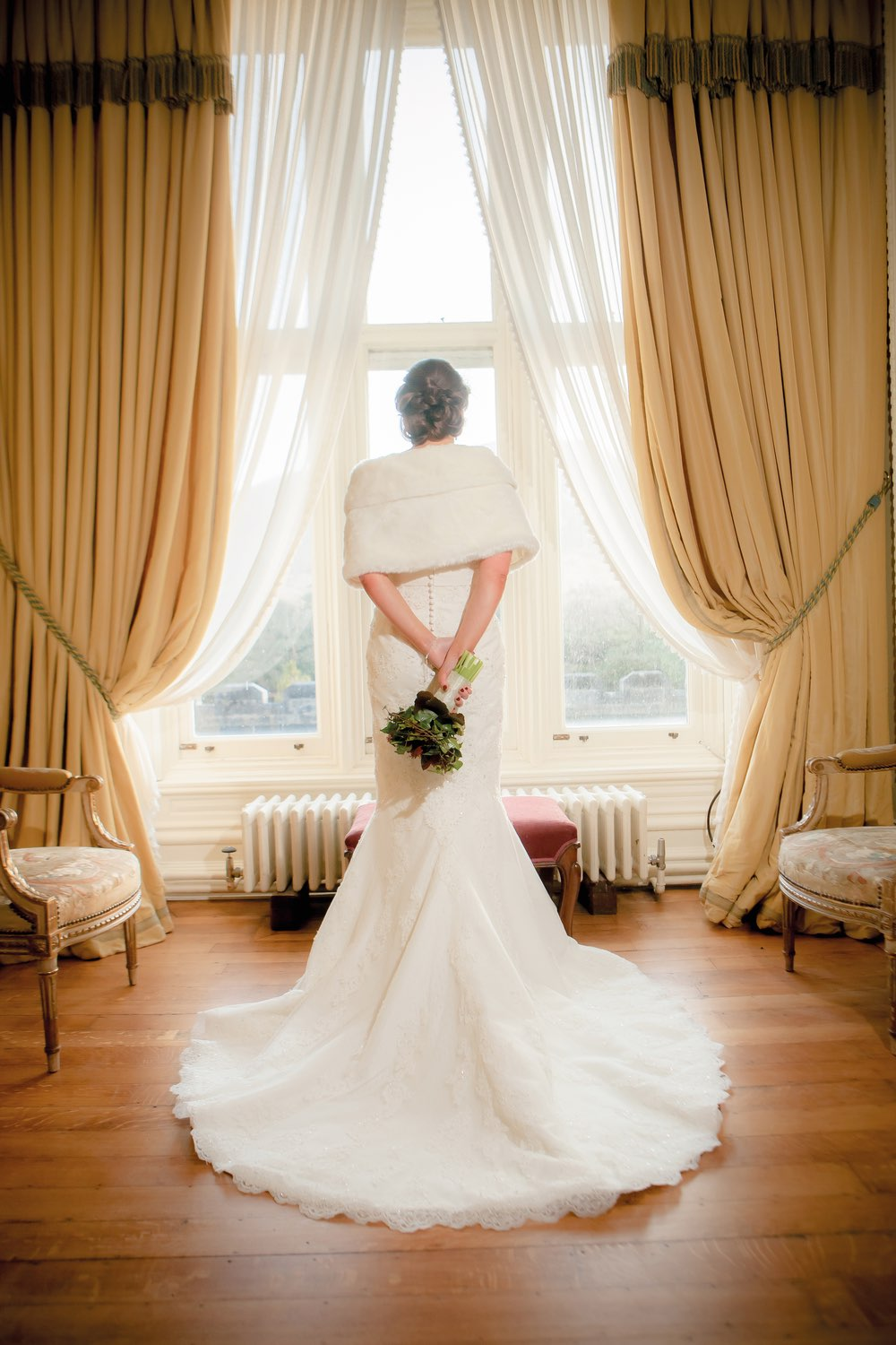 Ann-Marie Aspell gazing out the window in her wedding gown