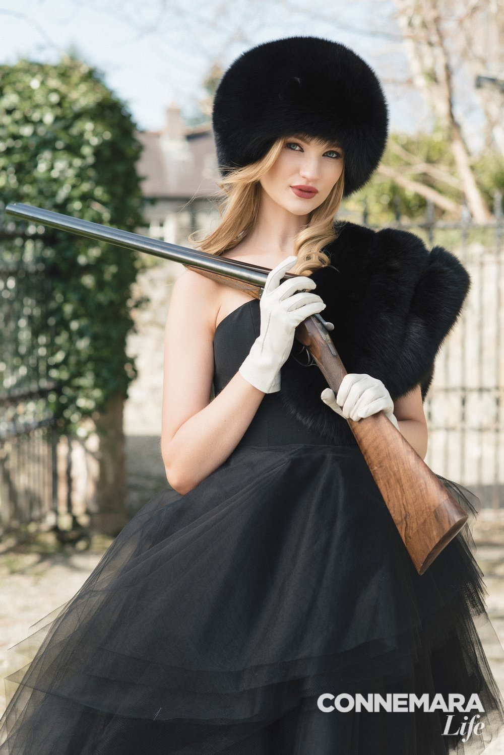 Christian Siriano gown, Resort 2015 collection; gloves, fox fur stole, and bubble hat in black by Surell Accessories