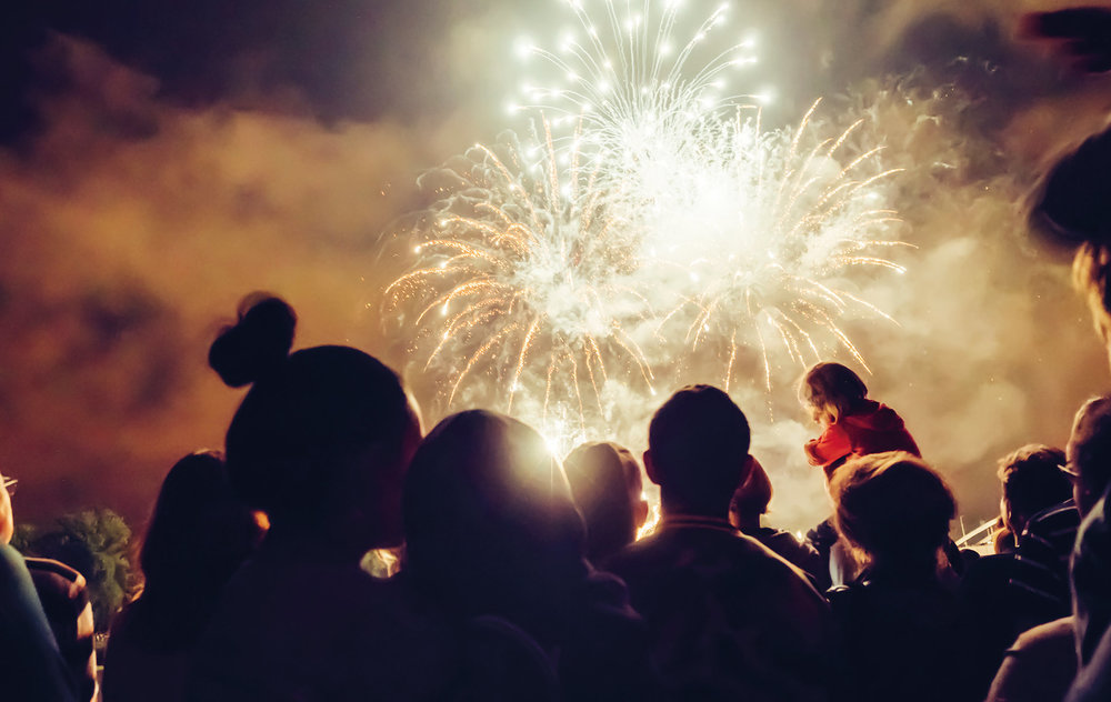 Crowd watches firework show at the Clifden Arts Festival