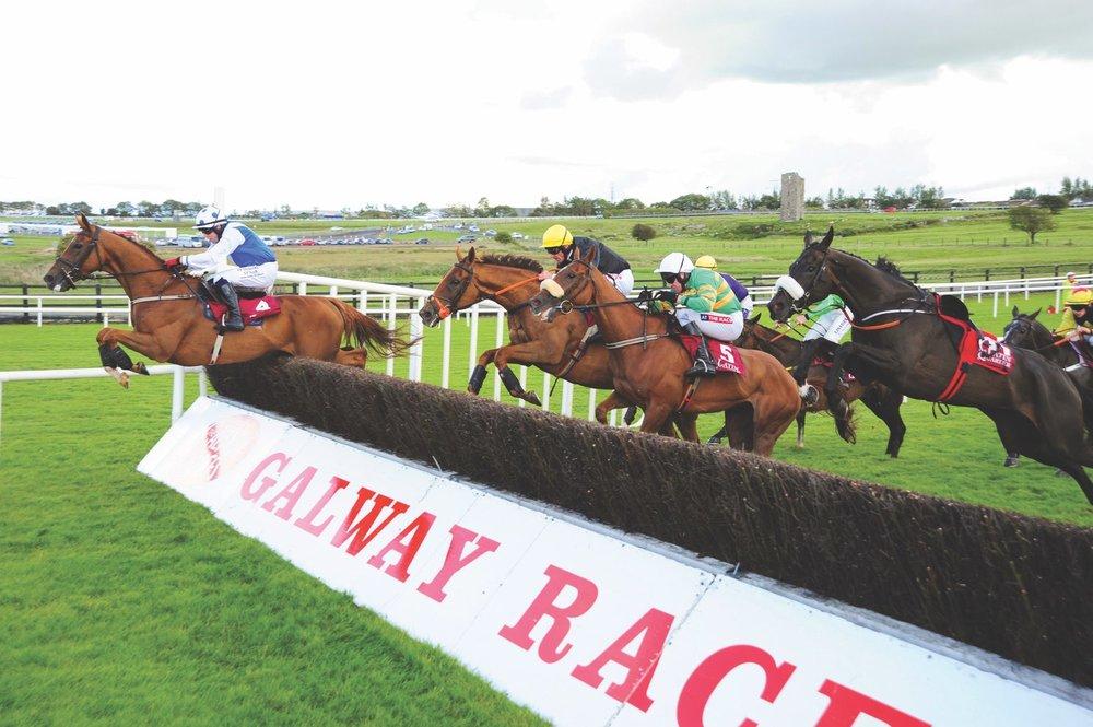 Jockeys compete at the Galway Race Week 2015.