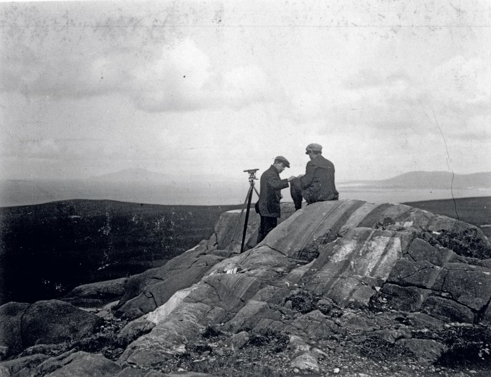Engineer B. J. Witt and local workman Peter Guy conduct research near mast No. 3 Currywongaun Hill.