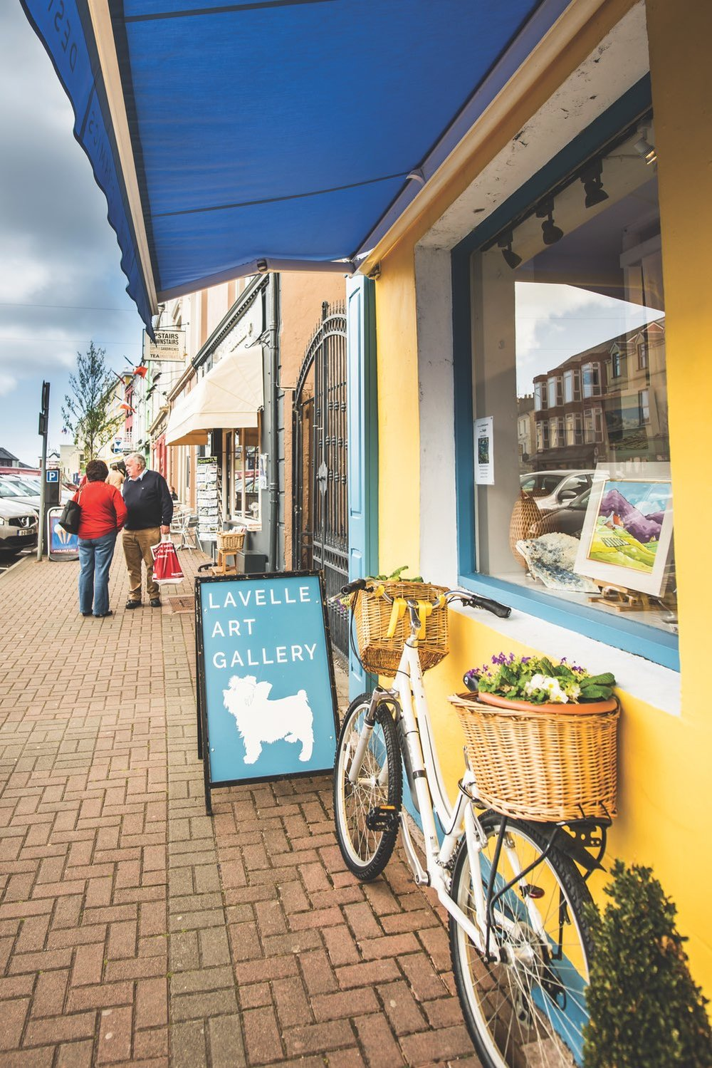 Today, Clifden's Main Street boasts colourful shops, galleries, pubs, cafes, and more.