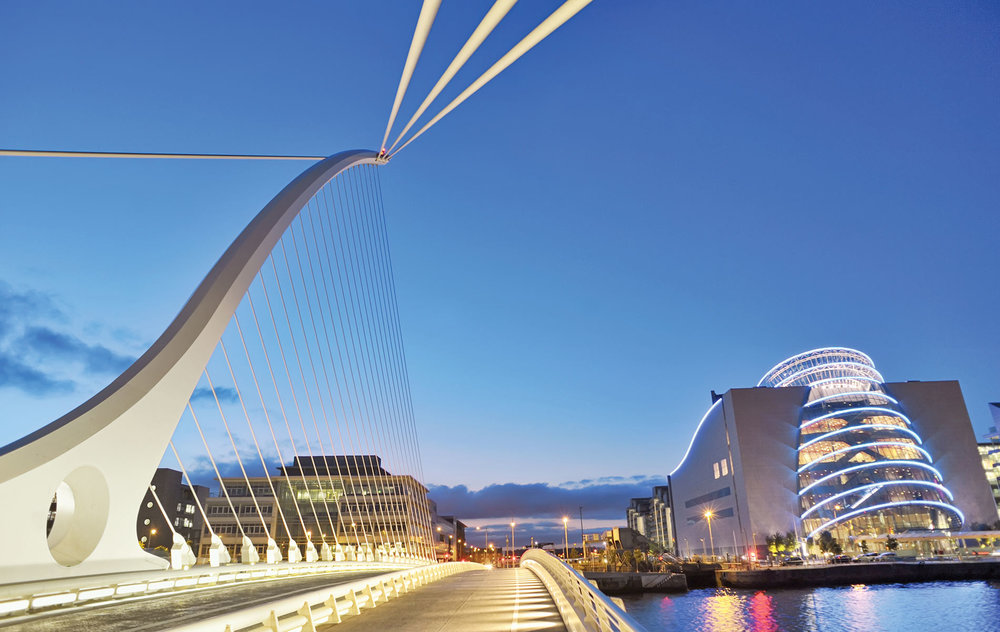 A sunset view of the striking Samuel Beckett Bridge with the Convention Centre Dublin in the background
