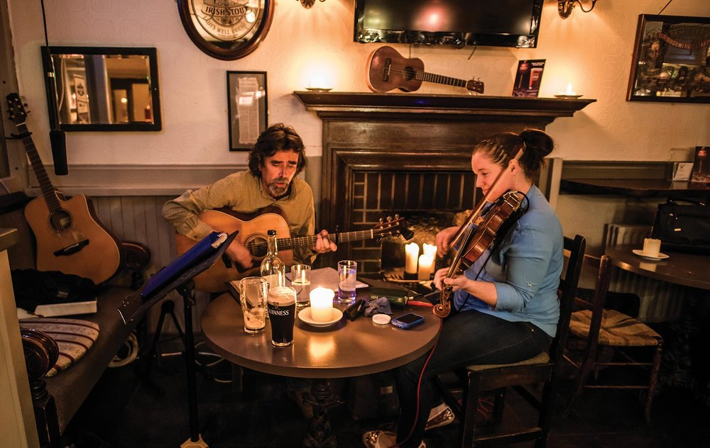 Couple playing music in Irish pub