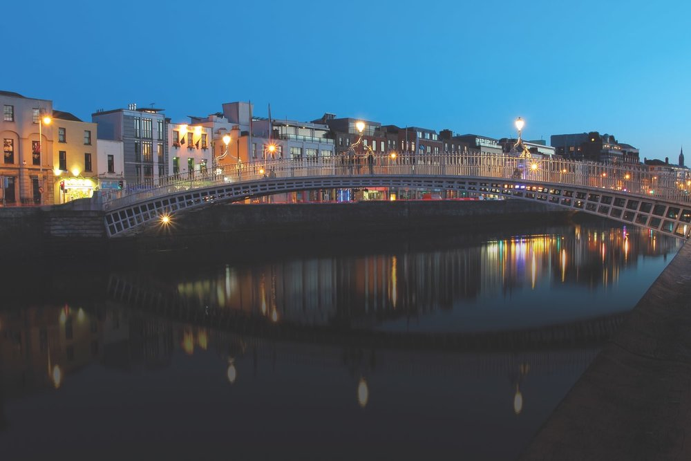 Dublin night scene of the Ha'penny Bridge and lights along the River Liffey