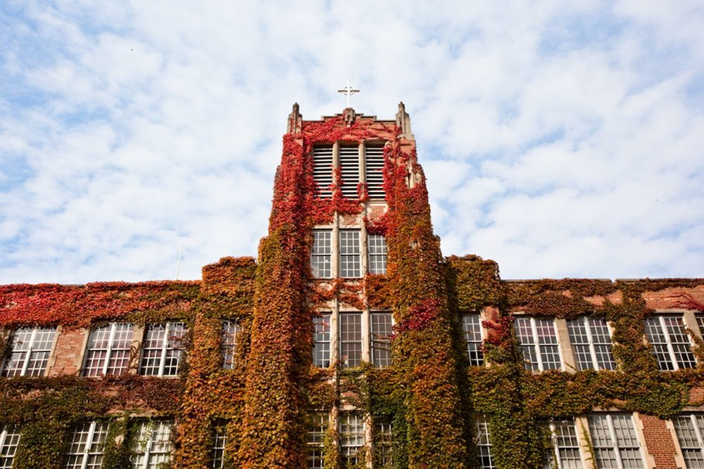 Aquinas College campus building covered in vines and foliage