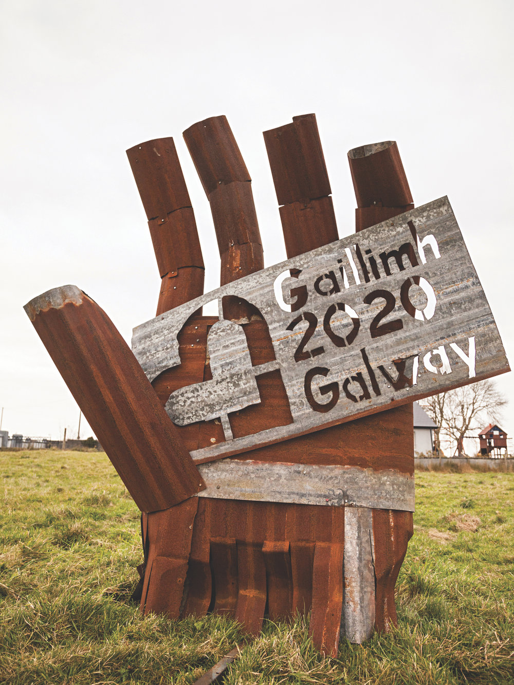 Sculptor Eugene Finnegan helped promote the 2020 bid with his massive sculpture made from found and reclaimed items.