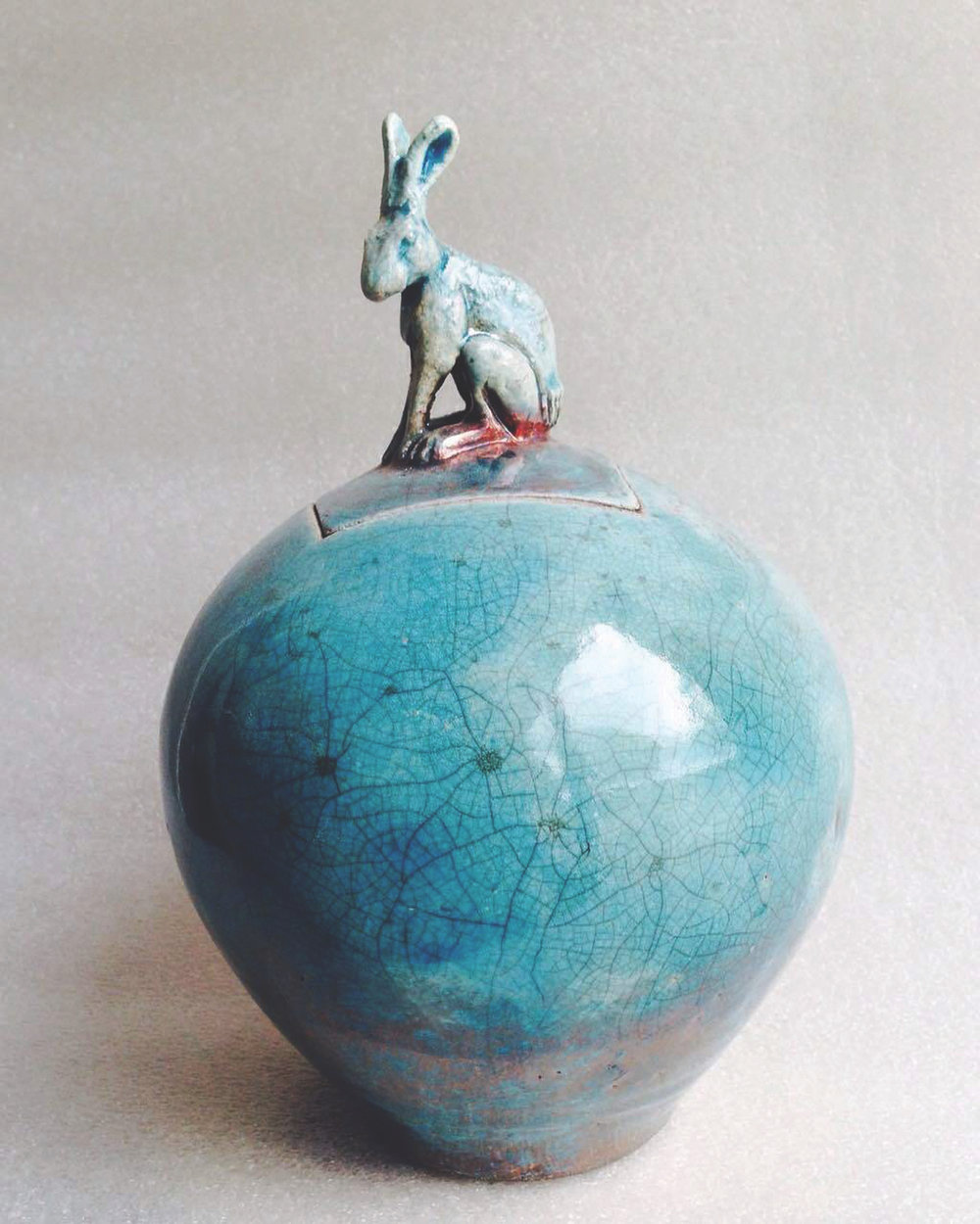 Raku pot with hare detail by Tom Callery.