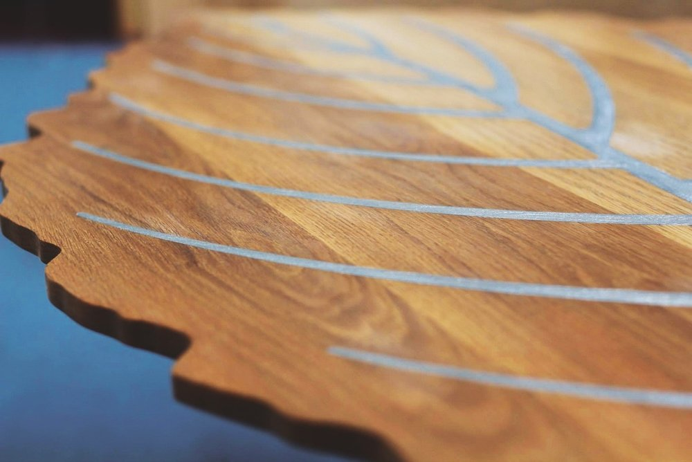 Tabletop of oak wood with pewter inlay by Shane Collins