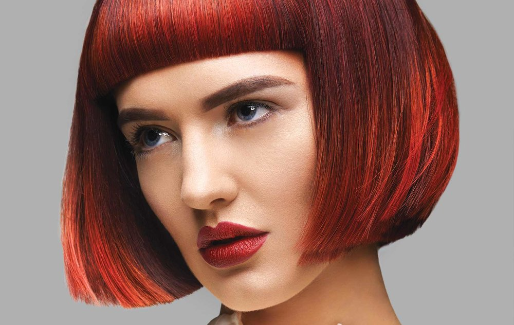 "The Ignium wig styles created by stylists from Bellissimo Galway represent the vibrancy and fire both in the salon's ""tribe"" members and the fiery colors they used in the collection."
