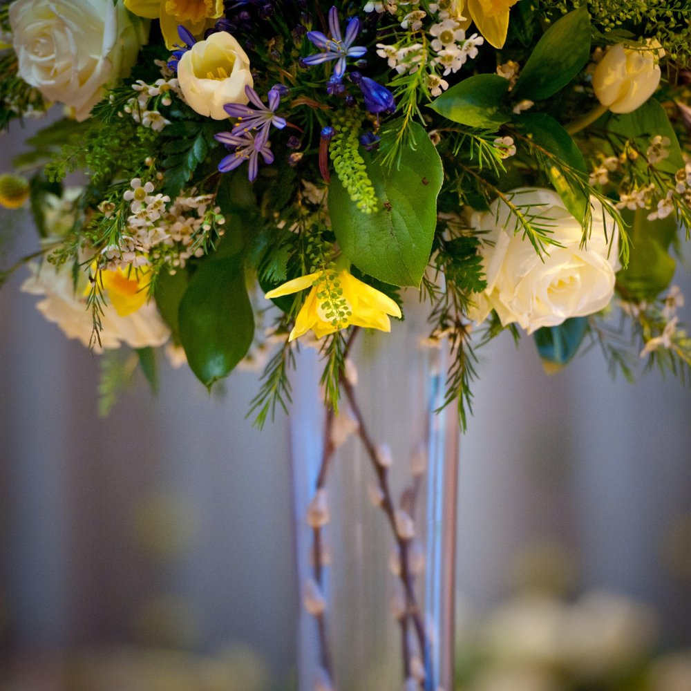 Tall vase spring flowers wedding.jpg