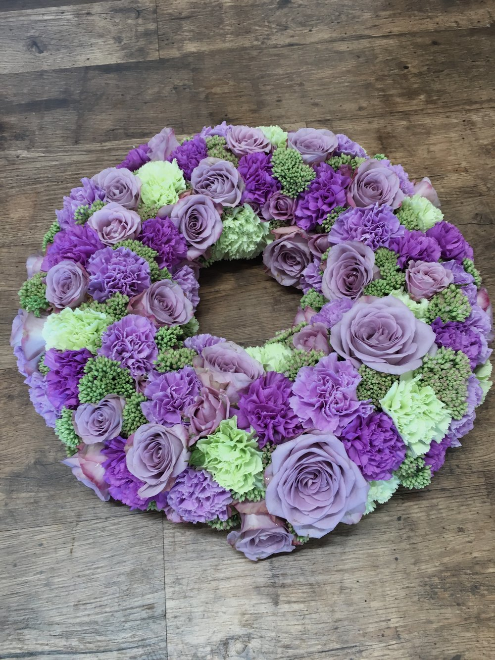 Compact classic wreath of Roses and Dianthus.jpg
