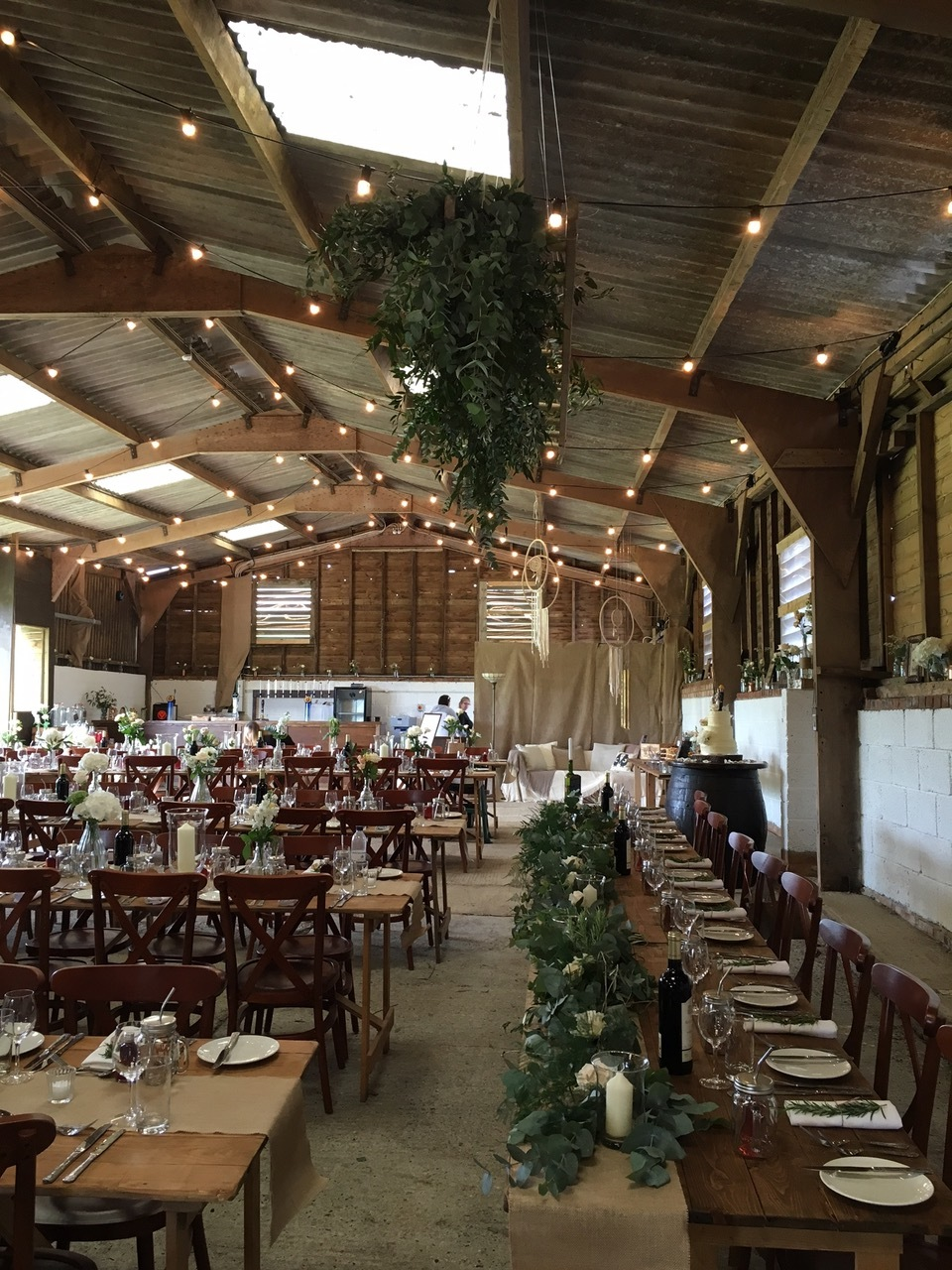 top table garland and ladder above.JPG