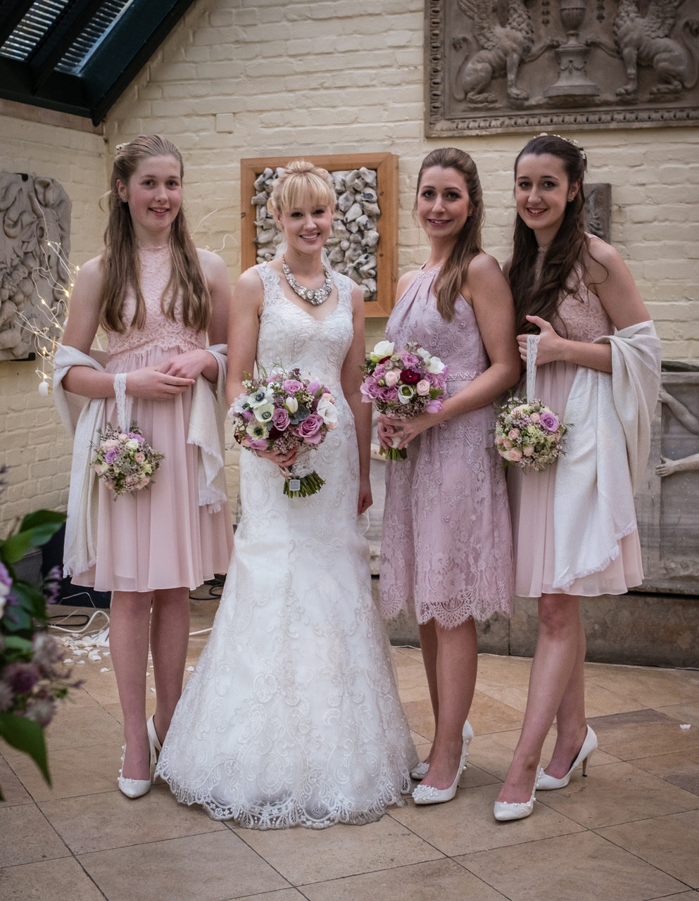 Bride and bridesmaids with bouquets at The Dairy Easter 2016 lilac, pink, white.jpeg