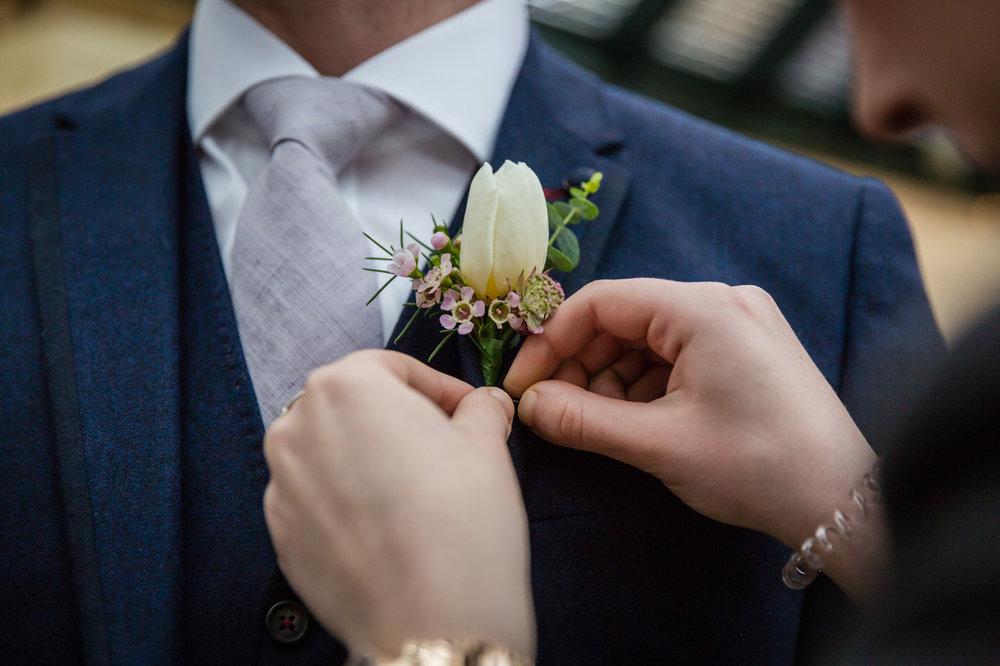 white Tulip buttonhole.jpeg