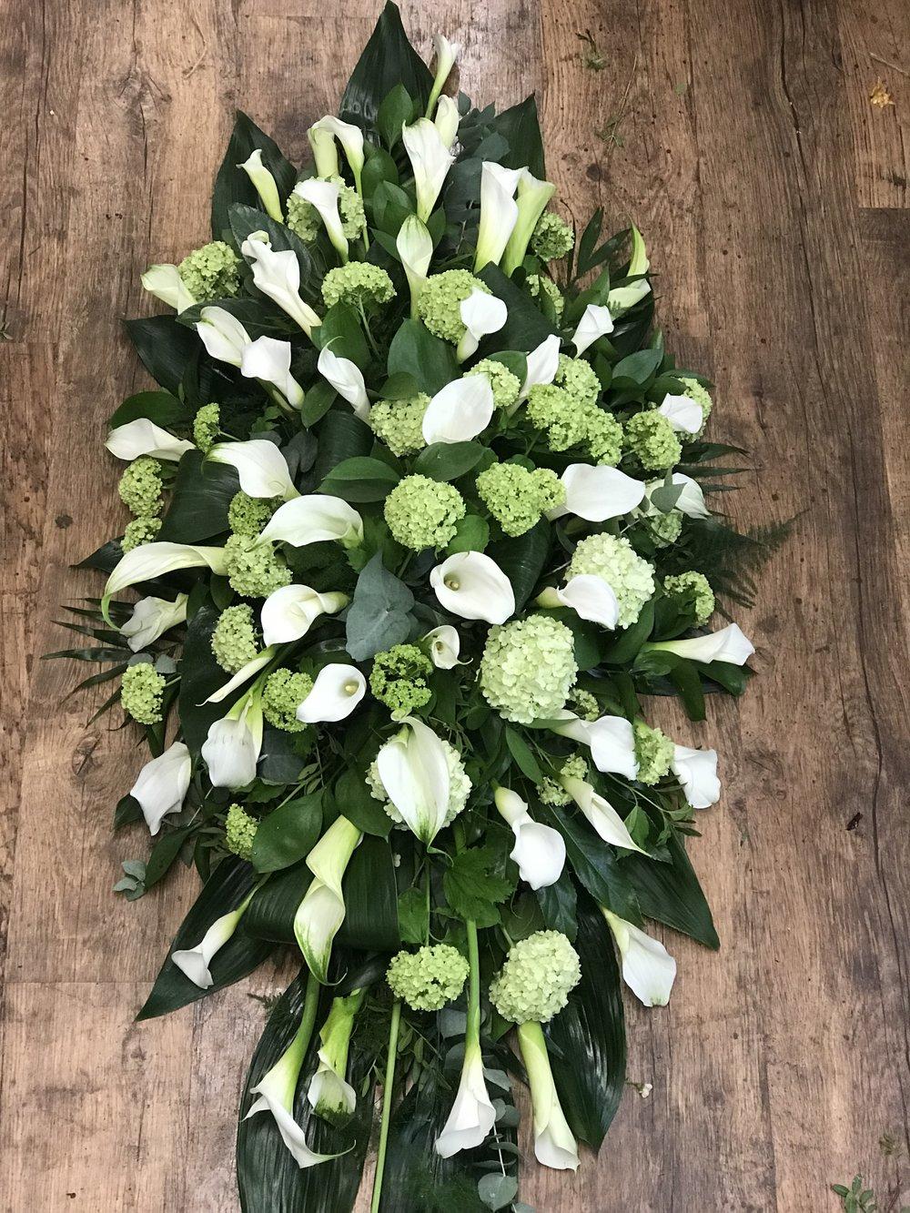 Luxury Arum Coffin Spray with seasonal Foliage