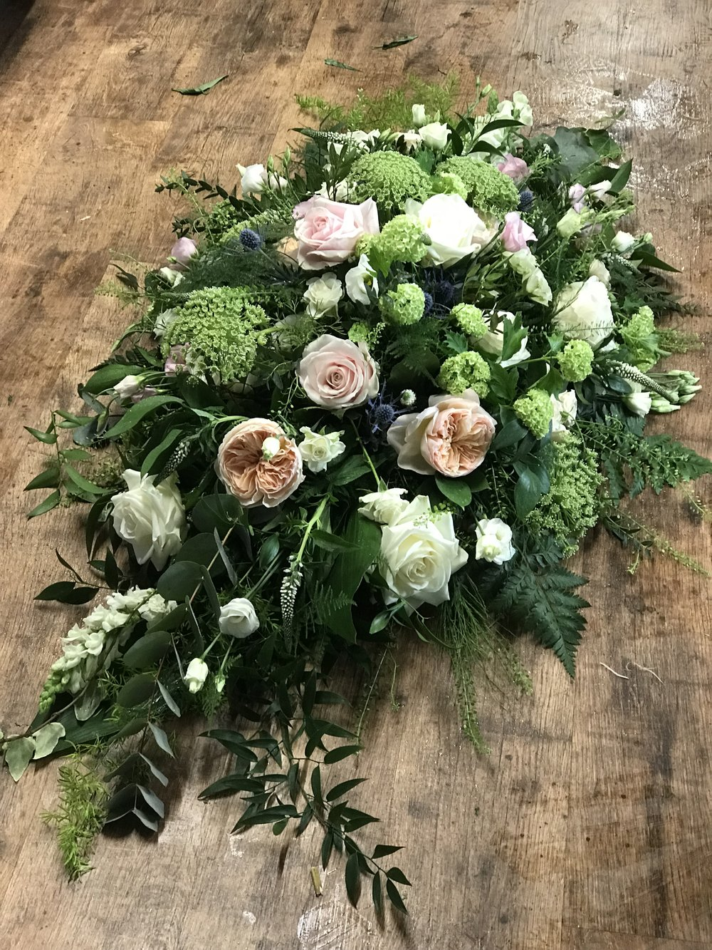 Country Garden Coffin Spray in ivory and peach